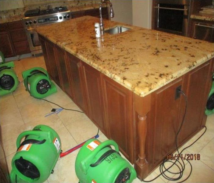 SERVPRO air movers set up in kitchen